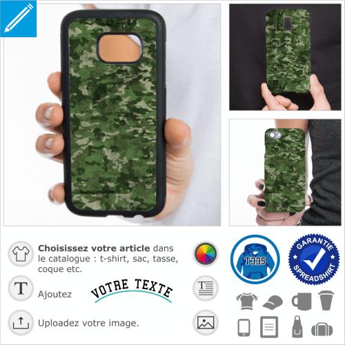 Camouflage militaire à petites taches vertes de différentes nuances et texture usée et marquée. Image haute résolution qui s'adapte aux différentes di