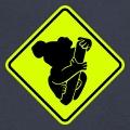 Koala stylisé dessiné de face et collé sur un panneau routier.