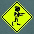 Panneau humour avec un personnage de zombie.
