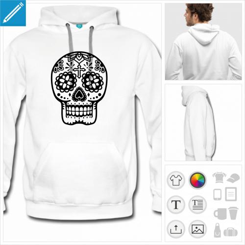 Hoodie uni vert et crâne fleuri style Mexique transparent avec croix sur le front et nez en cœur.