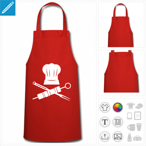 Tablier pirate composé d'une toque et de fourchette de barbecue et brochette croisées.